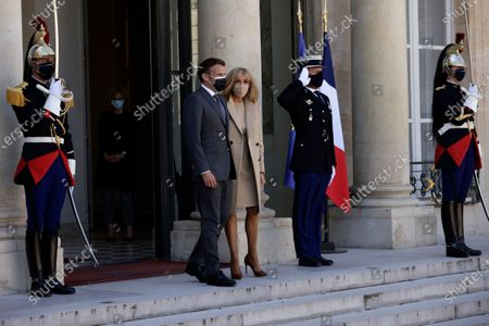 French President Emmanuel Macron, left, and French First Lady Brigitte Macron walk out to welcome German President Frank-Walter Steinmeier and his wife Elke Buedenbender upon their arrival at the Elysee Palace in Paris, France
