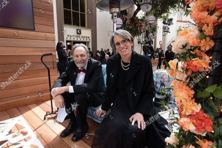 Oscar nominee Eric Roth and Debra Greenfield on the red carpet