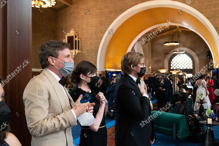 Peter Spears, Mollye Asher and Dan Janvey celebrate as Chloe Zhao accepts the Oscar for Directing during the live ABC Telecast of The 93rd Oscars at Union Station
