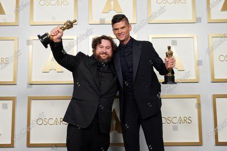 Stock Photo of Michael Govier and Will McCormack pose backstage with the Oscar® for Animated Short Film during the live ABC Telecast of The 93rd Oscars® at Union Station in Los Angeles, CA on Sunday, April 25, 2021.