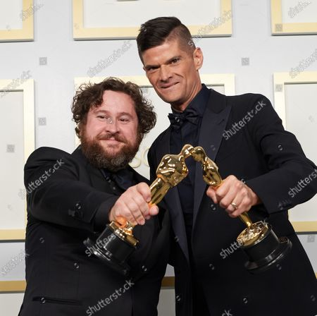 Michael Govier and Will McCormack pose backstage with the Oscar® for Animated Short Film during the live ABC Telecast of The 93rd Oscars® at Union Station in Los Angeles, CA on Sunday, April 25, 2021.
