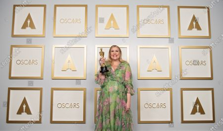 Emerald Fennell poses backstage with the Oscar® for Original Screenplay during the live ABC Telecast of The 93rd Oscars® at Union Station in Los Angeles, CA on Sunday, April 25, 2021.