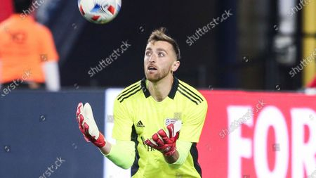 Stock Photo of New England Revolution goalkeeper Matt Turner (30) makes a save during an MLS soccer match against DC United, in Foxborough, Mass