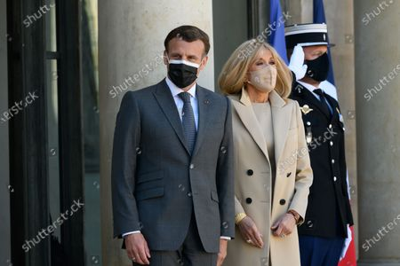Emmanuel and Brigitte Macron.  French President Emmanuel Macron and his wife Brigitte, welcome German President Frank-Walter Steinmeier and his wife Elke Budenbender as they arrive for a working lunch at the Elysee Palace.