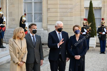 Brigitte and Emmanuel Macron, Frank-Walter Steinmeier and Elke Budenbender.  French President Emmanuel Macron and his wife Brigitte, welcome German President Frank-Walter Steinmeier and his wife Elke Budenbender as they arrive for a working lunch at the Elysee Palace.