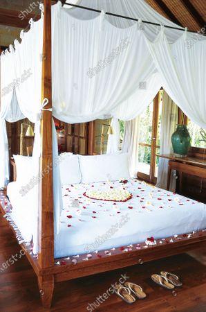 "A ""honeymoon bed,"" decorated with a rose-petal heart at Begawan resort, Bali."