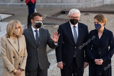 French President Emmanuel Macron together with his wife Breigitte Macron welcome the German Head of State, Frank-Walter Steinmeier, in the company of his wife Elke Budenbender, for a state visit and working lunch at the Elysee Palace, in Paris, on April 26, 2021.