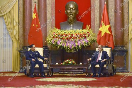 Stock Photo of (210426) - HANOI, April 26, 2021 (Xinhua) - Vietnamese President Nguyen Xuan Phuc (R) meets with Chinese State Councilor and Minister of National Defense Wei Fenghe in Hanoi, Vietnam, on April 26, 2021.