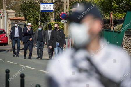 Stock Picture of French-Israeli writer Marek Halter (C), Drancy mosque's Imam Hassen Chalghoumi (center L) and Belgian Rabbin Levi Matusof (Center R) leave the Rambouillet police station after lay white roses to pay tribute to a police officer Stephanie M. stabbed to death on 23 April, in Rambouillet, near Paris, 26 April 2021. An official tribute is to be paid by the town hall of Rambouillet to Stephanie M. on 26 April. The rally will take place in front of the police station, where she was murdered.