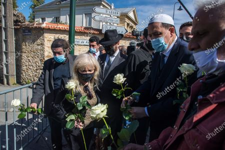 French-Israeli writer Marek Halter (L), Drancy mosque's Imam Hassen Chalghoumi (center R) and Belgian Rabbin Levi Matusof (C) lay white roses in front of the Rambouillet police station to pay tribute to a police officer Stephanie M. stabbed to death on 23 April, in Rambouillet, near Paris, 26 April 2021. An official tribute is to be paid by the town hall of Rambouillet to Stephanie M. on 26 April. The rally will take place in front of the police station, where she was murdered.