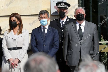 French Interior Minister Gerald Darmanin, second left, French Junior Minister of Citizenship Marlene Schiappa, left, President of the French Senate Gerard Larcher, right, and Director General of the French National Police Frederic Veaux, second right, attend a tribute in front of Rambouillet city hall to pay homage to police official who was stabbed death Friday in Rambouillet, south west of Paris, . Police also called for gatherings at police stations around France after the stabbing in Rambouillet, which authorities are investigating as a terrorist attack