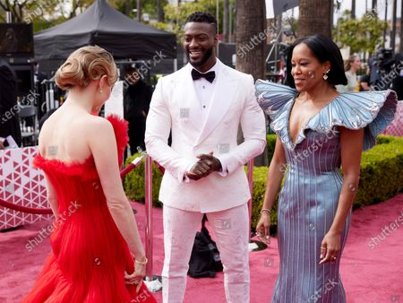 Stock Photo of Amanda Seyfried (L) and Regina King (R) and guests arrive on the red carpet of The 93rd Oscars® at Union Station in Los Angeles, CA on Sunday, April 25, 2021.