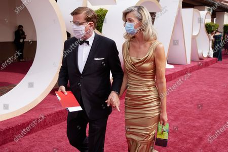 Aaron Sorkin (L) and Paulina Poriskova arrive on the red carpet of The 93rd Oscars® at Union Station in Los Angeles, CA on Sunday, April 25, 2021.