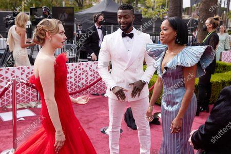 Stock Picture of Amanda Seyfried (L), Regina King (R) and guest arrive on the red carpet of The 93rd Oscars® at Union Station in Los Angeles, CA on Sunday, April 25, 2021.