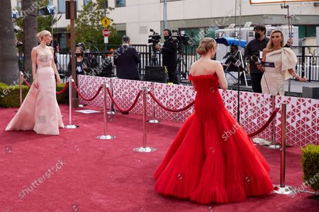 Oscar® nominees Vanessa Kirby (L) and Amanda Seyfried (R) and Regina King arrive on the red carpet of The 93rd Oscars® at Union Station in Los Angeles, CA on Sunday, April 25, 2021.