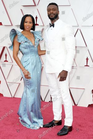 Stock Image of Regina King and Aldis Hodge arrive on the red carpet at The 93rd Oscars® at Union Station in Los Angeles, CA on Sunday, April 25, 2021.