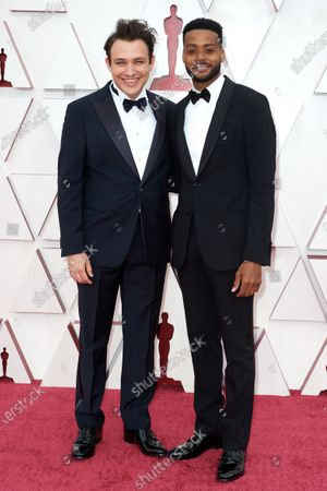 Kris Bowers (R) and guest on the red carpet of The 93rd Oscars® at Union Station in Los Angeles, CA on Sunday, April 25, 2021.