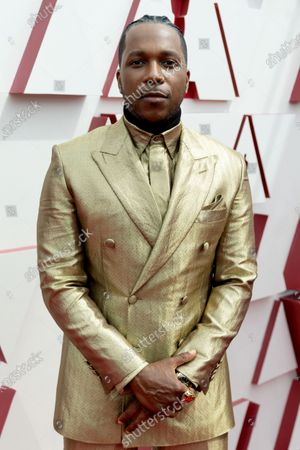 Stock Photo of Leslie Odom, Jr. arrives on the red carpet of The 93rd Oscars® at Union Station in Los Angeles, CA on Sunday, April 25, 2021.