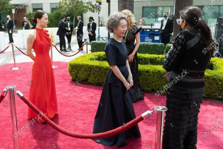 Yuh-Jung Youn (R) arrives with Han Ye-ri on the red carpet of The 93rd Oscars® at Union Station in Los Angeles, CA on Sunday, April 25, 2021.