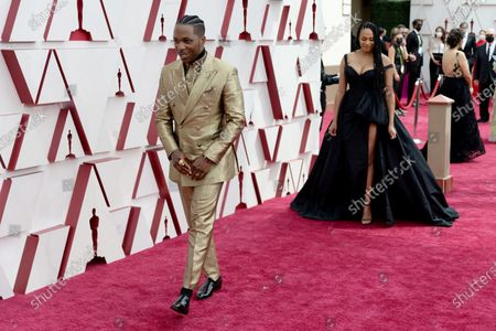 Stock Image of Leslie Odom, Jr. arrives on the red carpet of The 93rd Oscars® at Union Station in Los Angeles, CA on Sunday, April 25, 2021.