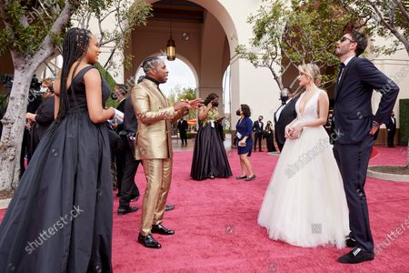 Oscar® nominees Leslie Odom, Jr. (2nd from L), and Maria Bakalova (3rd from L) and guests arrive on the red carpet of The 93rd Oscars® at Union Station in Los Angeles, CA on Sunday, April 25, 2021.