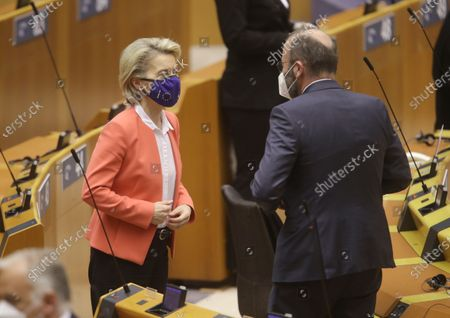 European Commission President Ursula von der Leyen (L) and Leader of the European People's Party at the European Parliament Manfred Weber interact during the first day of a plenary session of the European Parliament in Brussels, Belgium, 26 April 2021. Conclusions of the European Council and outcome of EU and Turkey meeting is the main debate.