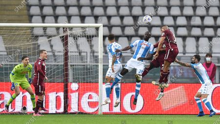 Napoli's Kalidou Koulibaly (C) in action against Torino's Gleison Bremer (2-R) during the Italian Serie A soccer match between Torino FC and SSC Napoli at the Olimpico Grande Torino stadium in Turin, Italy, 26 April 2021.