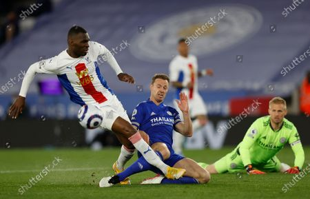 Crystal Palace's Christian Benteke, left, and Leicester's Jonny Evans challenge for the ball during the English Premier League soccer match between Leicester City and Crystal Palace at the King Power Stadium in Leicester, England