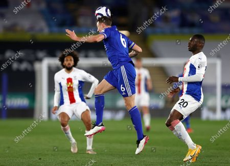 Leicester's Jonny Evans heads the ball during the English Premier League soccer match between Leicester City and Crystal Palace at the King Power Stadium in Leicester, England