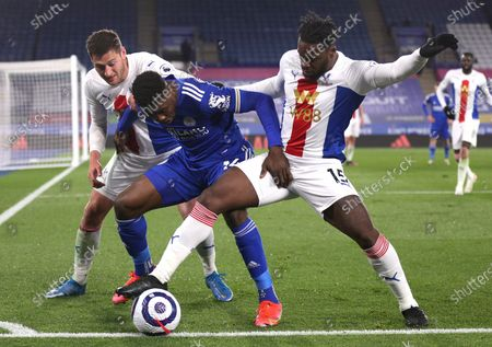 Crystal Palace's Joel Ward, left, Crystal Palace's Jeffrey Schlupp, right, and Leicester's Kelechi Iheanacho challenge for the ball during the English Premier League soccer match between Leicester City and Crystal Palace at the King Power Stadium in Leicester, England
