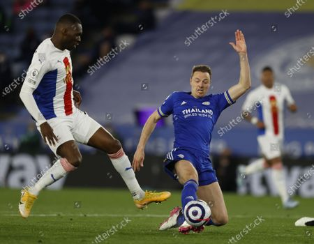 Jonny Evans (R) of Leicester in action against Christian Benteke (L) of Crystal Palace during the English Premier League soccer match between Leicester City and Crystal Palace in Leicester, Britain, 26 April 2021.