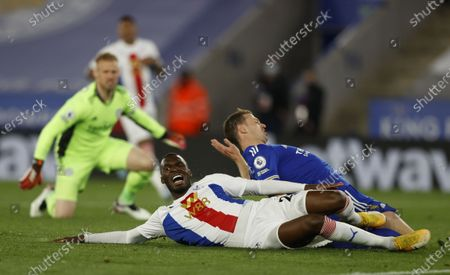Jonny Evans (R) of Leicester in action against Christian Benteke (front) of Crystal Palace during the English Premier League soccer match between Leicester City and Crystal Palace in Leicester, Britain, 26 April 2021.