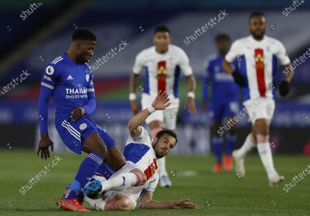 Kelechi Iheanacho (L) of Leicester in action against Luka Milivojevic (C) of Crystal Palace during the English Premier League soccer match between Leicester City and Crystal Palace in Leicester, Britain, 26 April 2021.