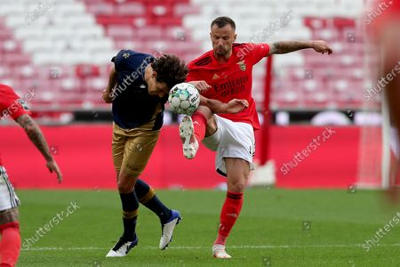 Haris Seferovic of SL Benfica (R ) vies with Joao Afonso of CD Santa Clara during the Portuguese League football match between SL Benfica and CD Santa Clara at the Luz stadium in Lisbon, Portugal on April 26, 2021.