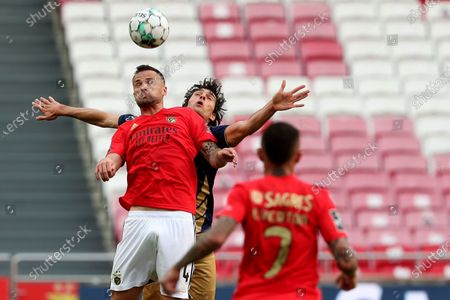 Haris Seferovic of SL Benfica (L) vies with Joao Afonso of CD Santa Clara (C ) during the Portuguese League football match between SL Benfica and CD Santa Clara at the Luz stadium in Lisbon, Portugal on April 26, 2021.