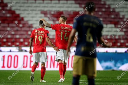 Chiquinho of SL Benfica (L ) celebrates with Haris Seferovic after scoring the Portuguese League football match between SL Benfica and CD Santa Clara at the Luz stadium in Lisbon, Portugal on April 26, 2021.