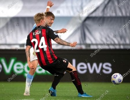Lazio's Ciro Immobile (back) and Milan's Simon Kjaer (front) in action during the Italian Serie A soccer match between SS Lazio and AC Milan at Olimpico Stadium in Rome, Italy, 26 April 2021.