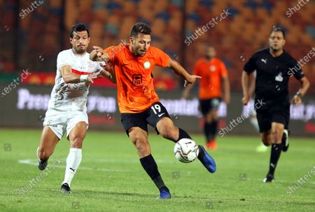 Stock Image of Zamalek's Tarek Hamed (L) in action against National Bank's Fady Farid (C) during the Egyptian Premier League soccer match between Zamalek SC and National Bank of Egypt SC in Cairo, Egypt, 26 April 2021.