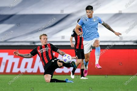 Simon Kjaer of AC Milan and Joaquin Correa of SS Lazio compete for the ball during the Serie A match between SS Lazio and AC Milan at Stadio Olimpico, Rome, Italy on 26 April 2021.