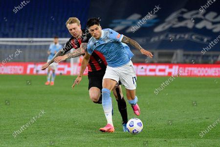 Joaquin Correa of SS Lazio and Simon Kjaer of AC Milan seen in action
