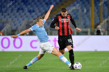Theo Hernandez of AC Milan and Lucas Leiva of SS Lazio seen in action