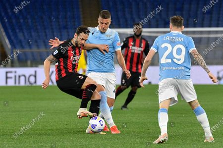 Hakan Calhanoglu of AC Milan and Sergej Milinkovic-Savic of SS Lazio seen in action