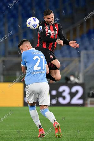 Theo Hernandez of AC Milan and Sergej Milinkovic-Savic of SS Lazio seen in action