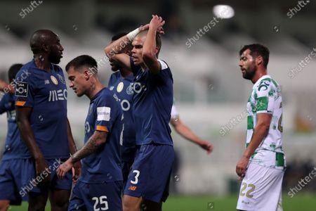Stock Photo of FC Porto players react during their Portuguese First League soccer match against Moreirense at Comendador Joaquim de Almeida Freitas stadium, at Moreira de Conegos, north of Portugal, 26 April 2021.