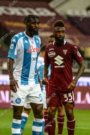 Stock Photo of Tiemoue Bakayoko of SSC Napoli and Nicolas Nkoulou during the Serie A football match between Torino FC and SSC Napoli. Sporting stadiums around Italy remain under strict restrictions due to the Coronavirus Pandemic as Government social distancing laws prohibit fans inside venues resulting in games being played behind closed doors.