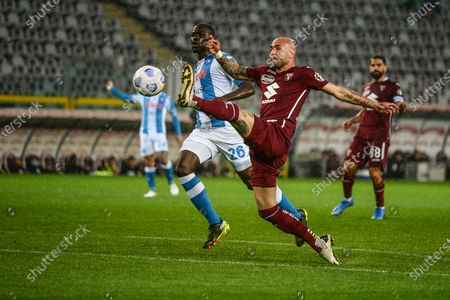 Simone Zaza of Torino FC and Kalidou Koulibaly of SSC Napoli during the Serie A football match between Torino FC and SSC Napoli. Sporting stadiums around Italy remain under strict restrictions due to the Coronavirus Pandemic as Government social distancing laws prohibit fans inside venues resulting in games being played behind closed doors.