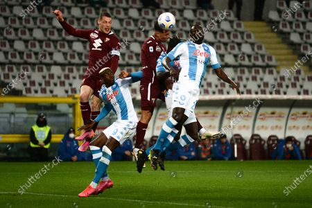 Andrea Belotti, Armando Izzo of Torino FC  and Victor Osimhen of SSC Napoli and Kalidou Koulibaly of SSC Napoliduring the Serie A football match between Torino FC and SSC Napoli. Sporting stadiums around Italy remain under strict restrictions due to the Coronavirus Pandemic as Government social distancing laws prohibit fans inside venues resulting in games being played behind closed doors.