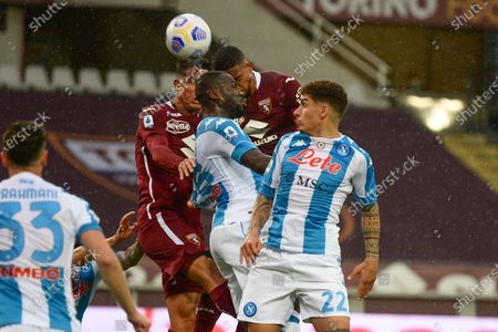 Armando Izzo of Torino FC  and Gleison Bremer of Torino FC  Kalidou Koulibaly of SSC Napoli and Giovanni Di Lorenzo of SSC Napoli during the Serie A football match between Torino FC and SSC Napoli. Sporting stadiums around Italy remain under strict restrictions due to the Coronavirus Pandemic as Government social distancing laws prohibit fans inside venues resulting in games being played behind closed doors.