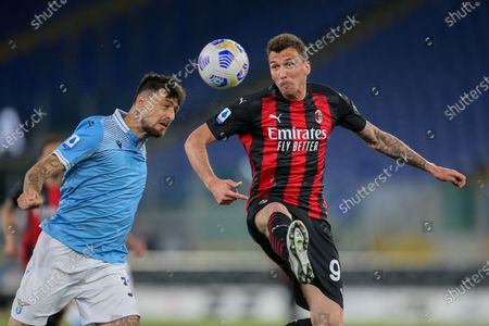 Mario Mandzukic of AC Milan is challenged by Francesco Acerbi of SS Lazio during the Italian Serie A football match between SS Lazio and AC Milan at Olympic Stadium in Rome, Italy on April 26, 2021. SS Lazio won the match 3-0.