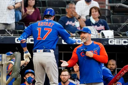 Stock Picture of Chicago Cubs' Kris Bryant (17) is greeted as he returns to the dugout by manager David Ross after hitting a grand slam in the third inning of a baseball game against the Atlanta Braves, in Atlanta